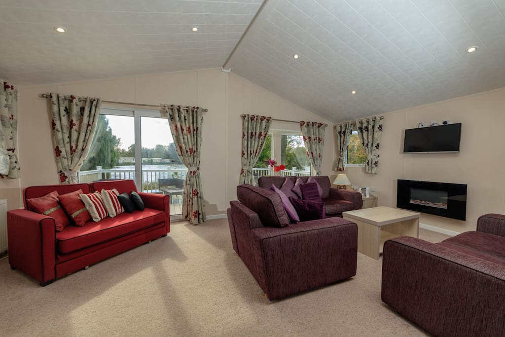 Lounge/living room showing the decking and lake