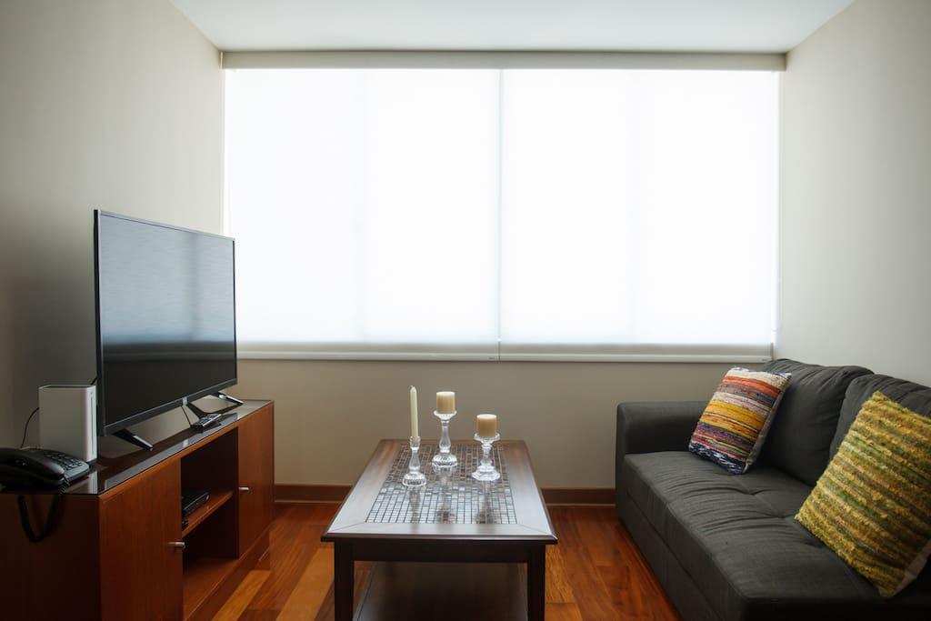 Sala con TV con cable, WiFi y teléfono.