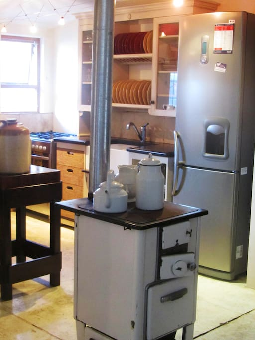 A Cozy farm style Kitchen with a traditional Agga Stove to keep you warm in winter