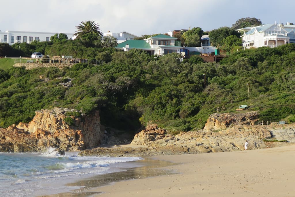 The Little Sanctuary is the house with the green roof, directly above the Lookout Beach