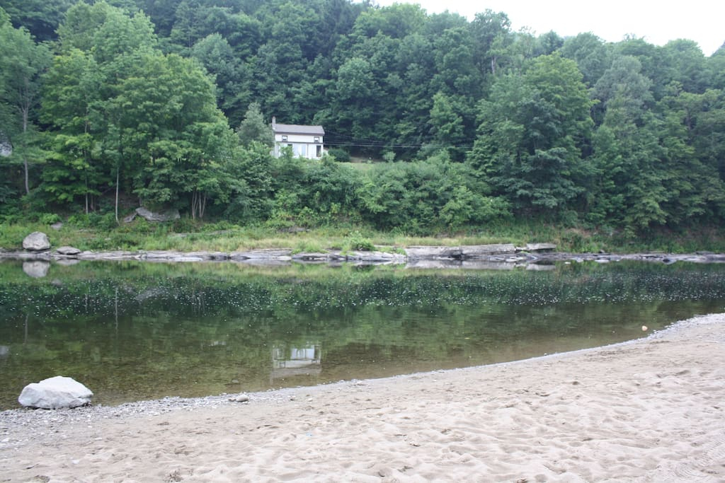 View of house and river from the gravel beach on the other side