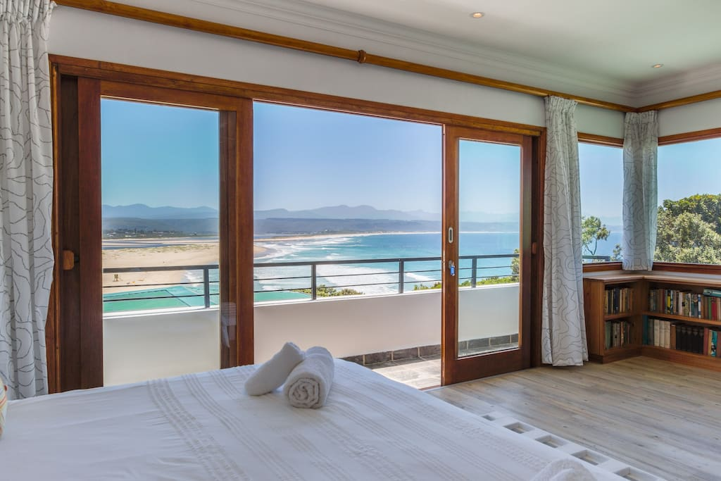 Wake up to this amazing view of the sea, lagoon and distant mountains