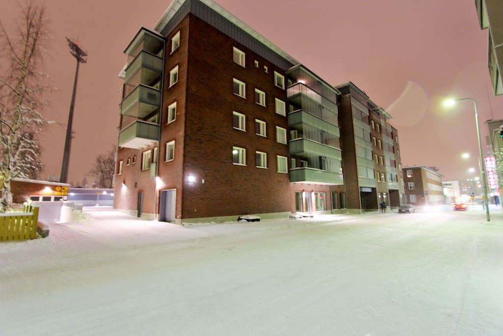 our building in wintertime by night