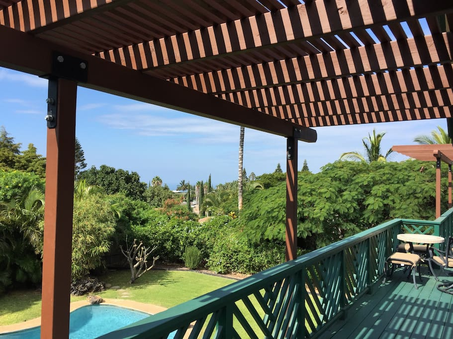 Upper lanai with a view of the ocean from your bedroom