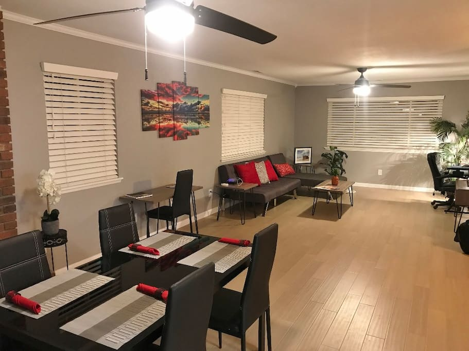 The dining table has enough room for 4 but there are 6 chairs. A side table can be added for more room. Additional seating on the nearby patio has a table that you can set for 6 people.