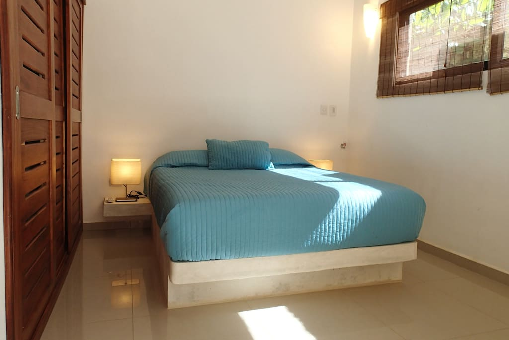 Master bedroom with comfortable Queen size bed