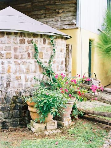 The original rainwater harvesting tank at the straw bale house.