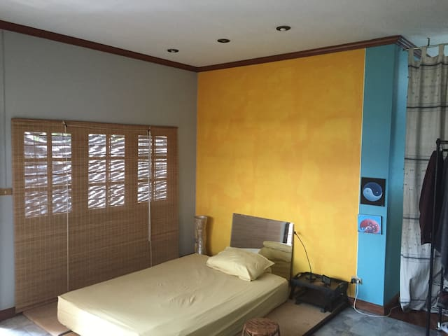 Your room - very large, bright and airy. There are 3 big windows and a private balcony.