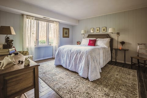 Comfy Queen bedroom with spacious closet, and wooded view