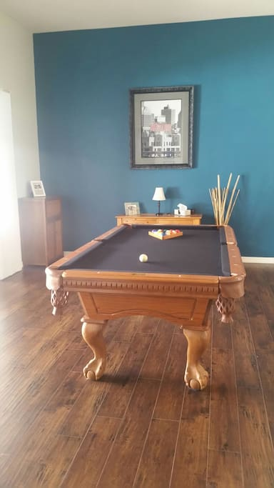 Pool table and game cabinet