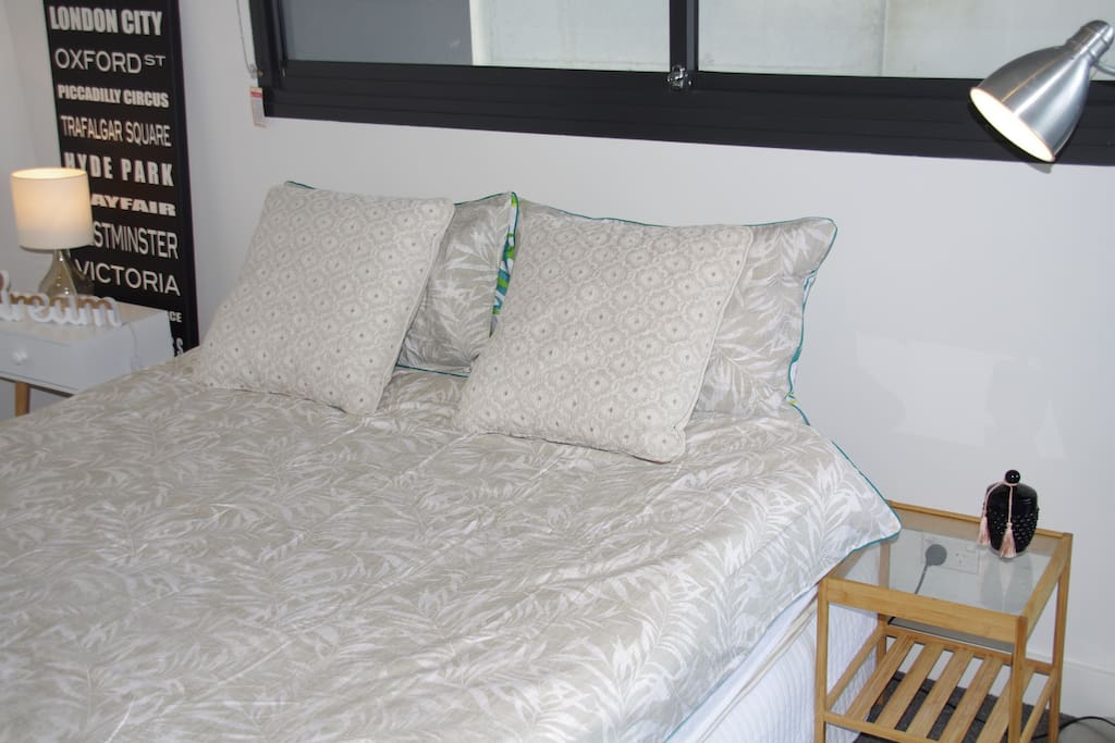 Master bedroom with queen bed, access to balcony and plenty of cupboard space with built-in wardrobes
