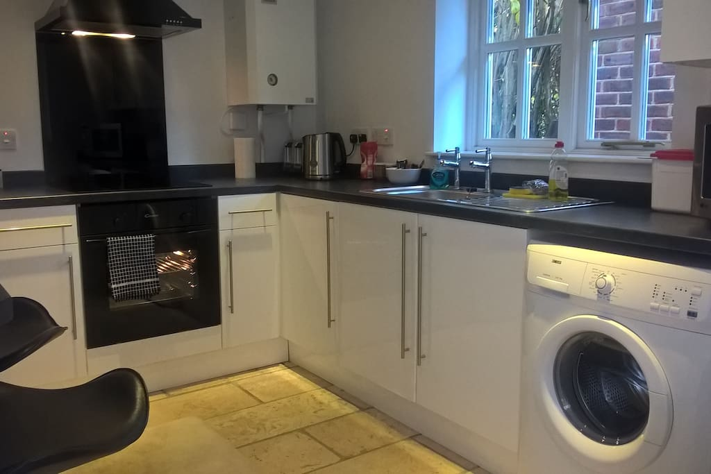 Fitted kitchen with an induction hob