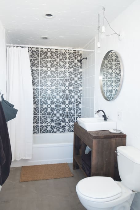 Totally renovated bathroom with lovely Portuguese tile.