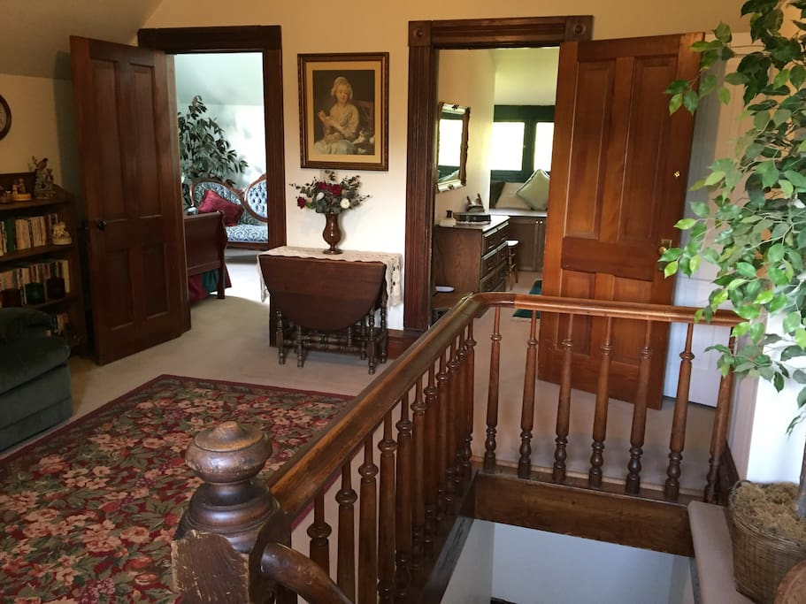 This shows the dropleaf table in the sitting room and doorways to both bedrooms.