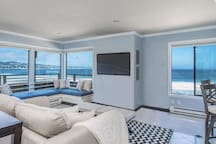 Welcome to Beach Front Paradise! Enjoy the stunning wrap around views from the living area.