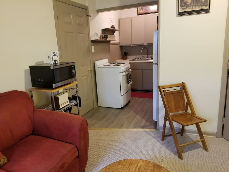 The efficiency kitchen is in adjacent to the living room. All appliances and utensils are included.