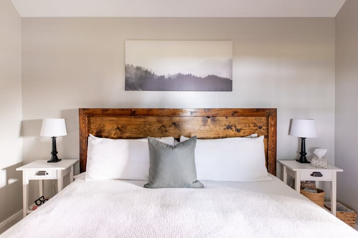 Inside your comfy King-sized bed, you will find soft and breathable linens and comfortable medium-firm pillows (the option for a more supportive memory foam pillow will be in your closet). This one-of-a-kind bed was made locally here in Essex County!