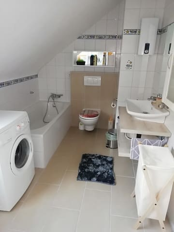 Private bathroom with washing machine