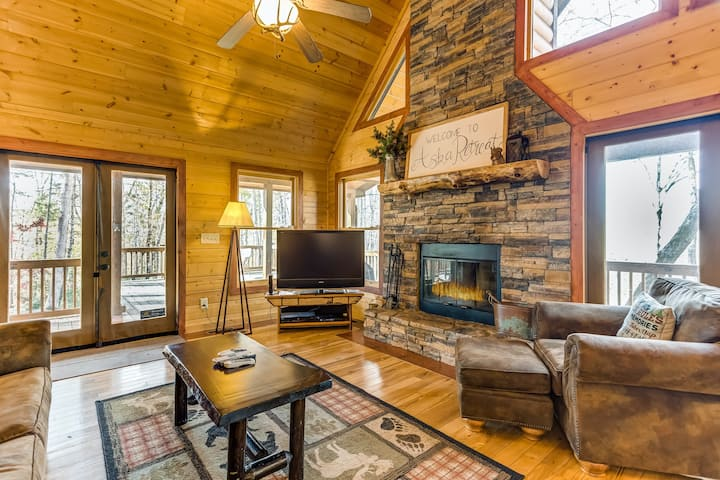 Dog-friendly mountain cabin w/ a private hot tub, screened porch, & views