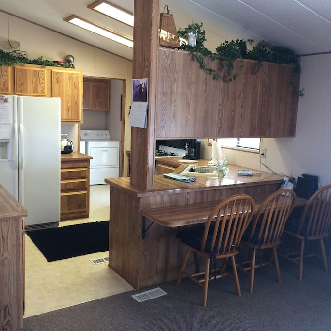 fully equipped open kitchen, brand new fridge, new stove