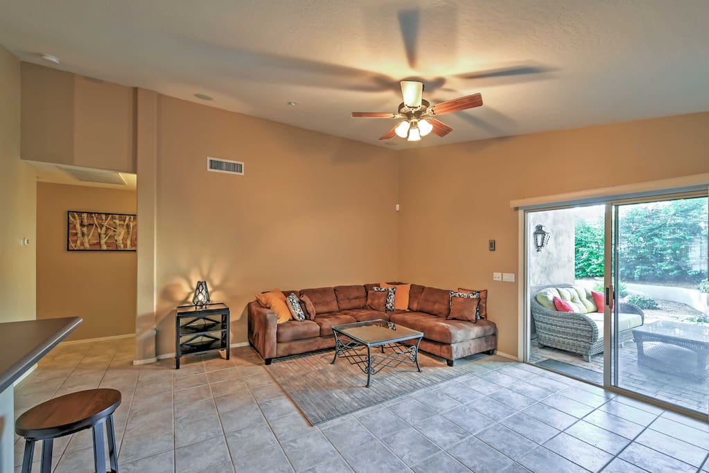 The spacious living area features a cozy couch to lounge on.