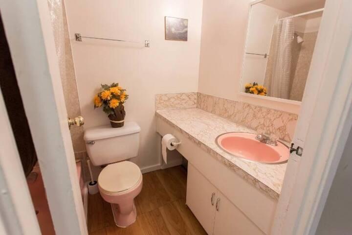Bathroom with bathtub.