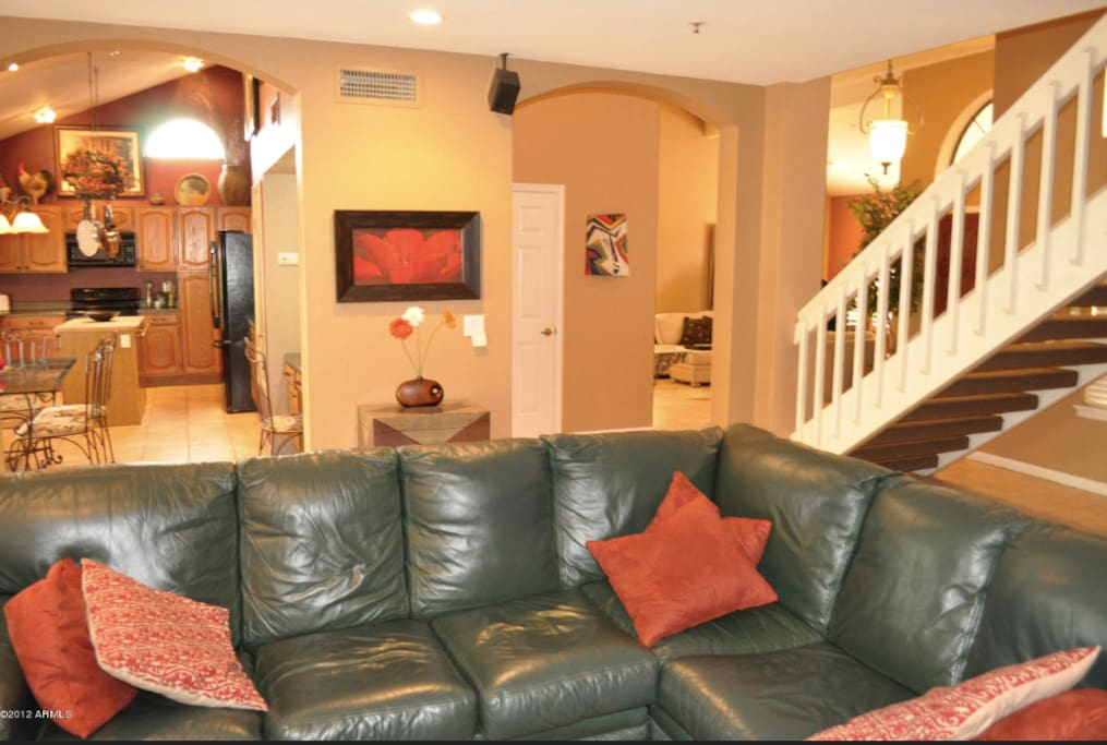 Very comfortable family room with built in TV unit on adjacent wall