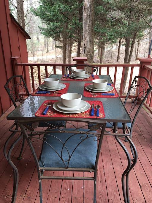 A spacious covered porch invites al fresco dining