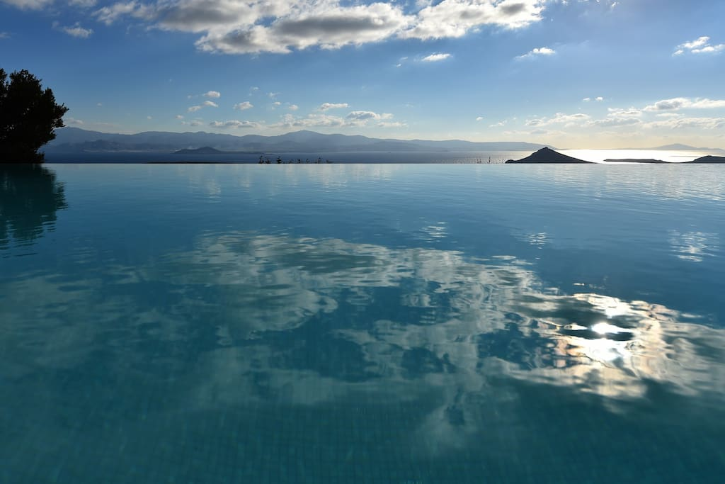 Enjoy your swim in the infinity pool with views of the Aegean during the day and the stars during the night