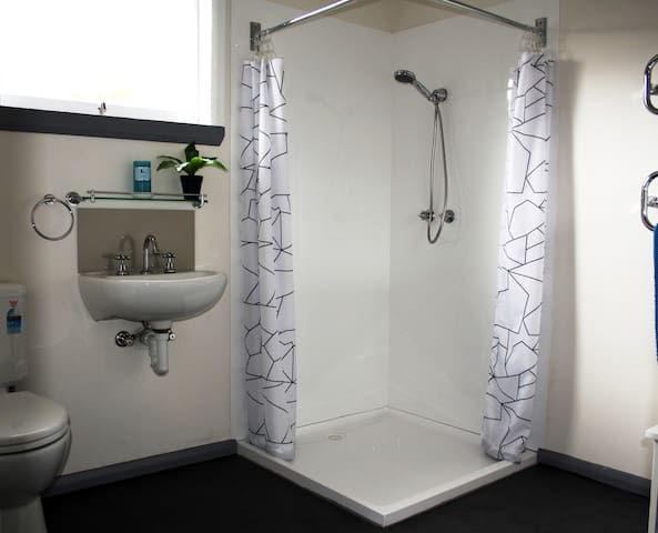Large walk in shower, toilet with grab rails, heated towel rail, soaps and shampoos, hairdryer, even a heat mat for your straighteners....
