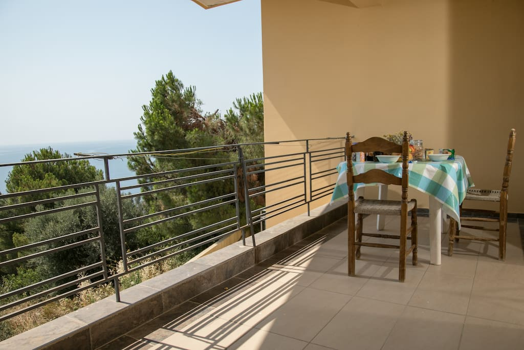 The spacious balcony offers guests an expansive view of the Laconic Gulf and its surroundings.