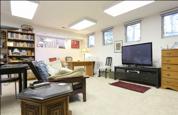 Shared office, family and TV room has a dining table and desk for guest use