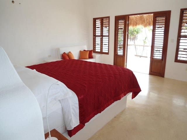 Master bedroom with king size bed, large terrace overlooking the beach and sea and with its en-suite bathroom