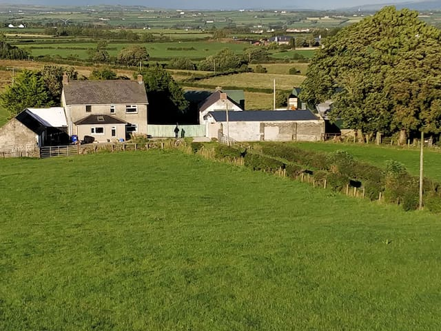 House and yard separated from the farm with large gates