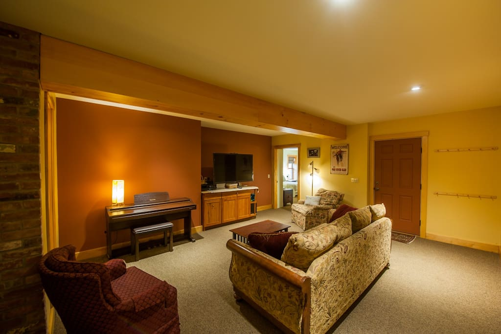 Suite includes bedroom, private living room, private bath and small, attached garage.