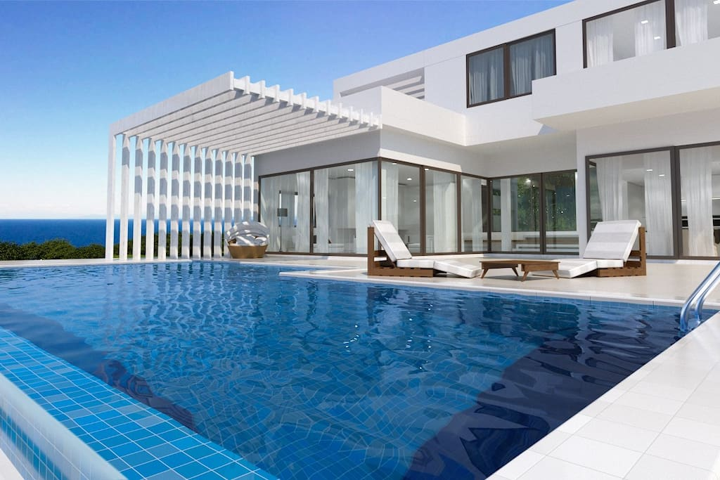 Large openings to have unlimited views to the sea. Swimming pool - 74 m2 - with jakuzzi.
