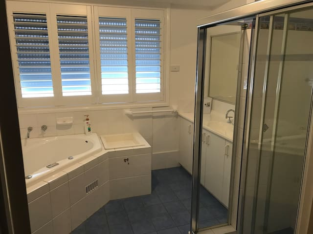 Bathroom comprising of bath, shower, sink and toilet