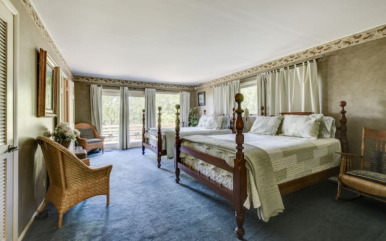 The largest bedroom boasts 2 queen size beds and lots of natural light.