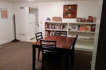 Dining room with books, games and second table for eating (6 person in kitchen)