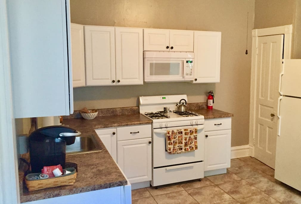 Kitchen with Keurig and coffee included; dishwasher, refrigerator, and microwave equipped