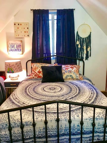 Bohemian masterpiece! Upstairs bedroom, newly renovated and decorated for your pleasure. Everything brand new, including bedding and mattresses.