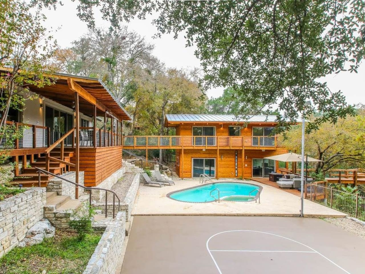 Lower Deck, pool with jacuzzi, b-ball court and Guest House