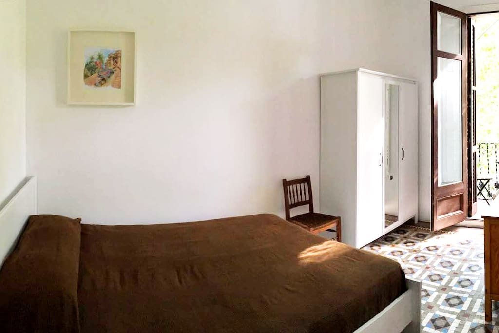 Bright room with double bed and with private balcony