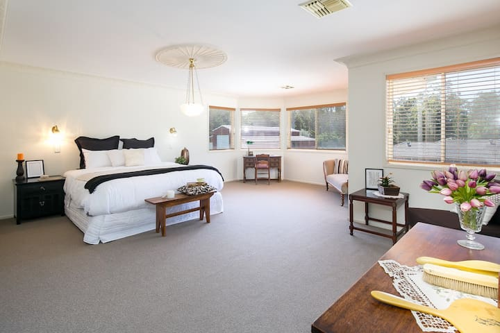The Master Bedroom is a real retreat.  A wonderful room to get ready for a wedding at the Sirromet Winery Mount Cotton or the Court House in Cleveland !