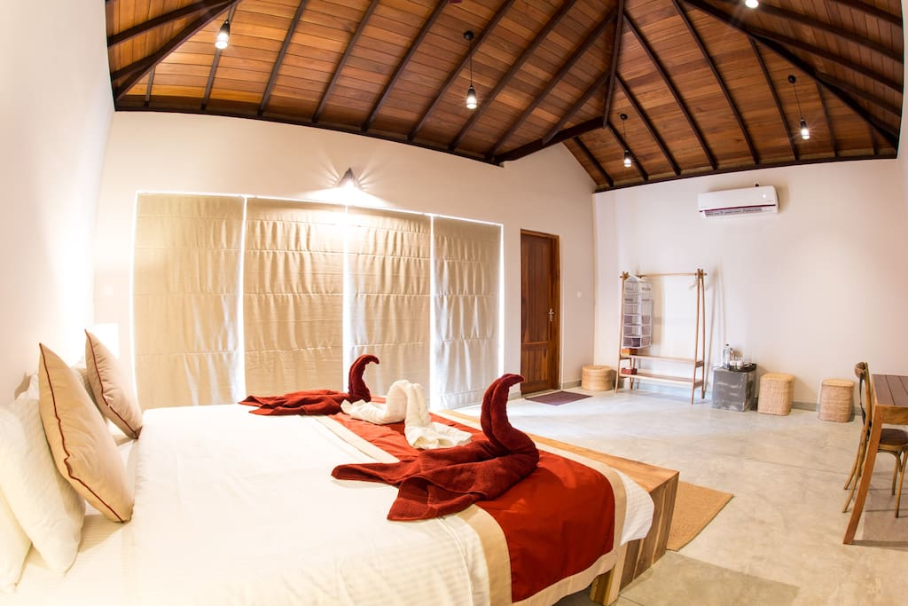 Rooms include a private garden, modern ensuite bathroom, storage space for clothes and extra seating