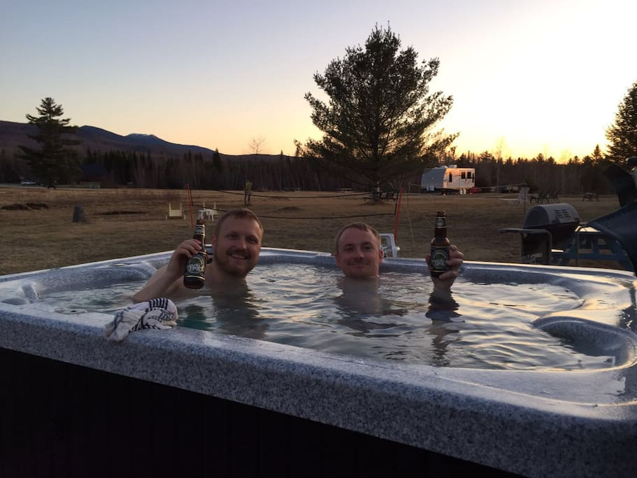 guest enjoying the hot tub at sunset