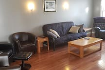 Living Room (1st FLR) - Queen Size Futon and plenty of seating.