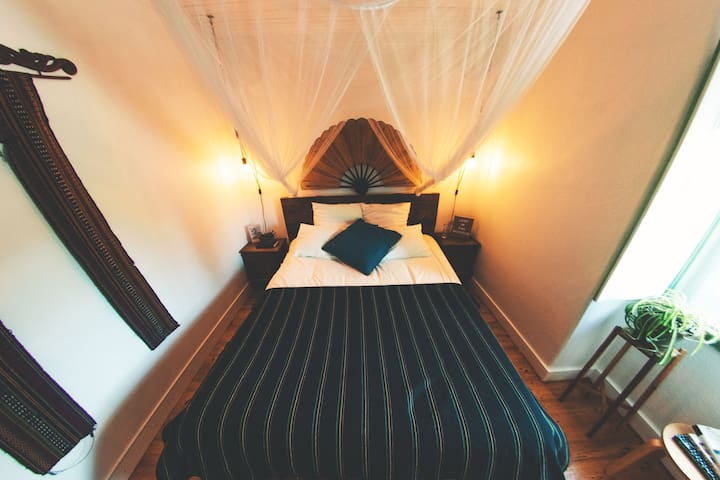 The master bedroom with queen sized bed