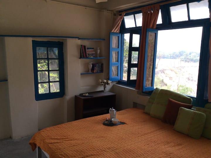 Quaint bed above a roaring Yamuna