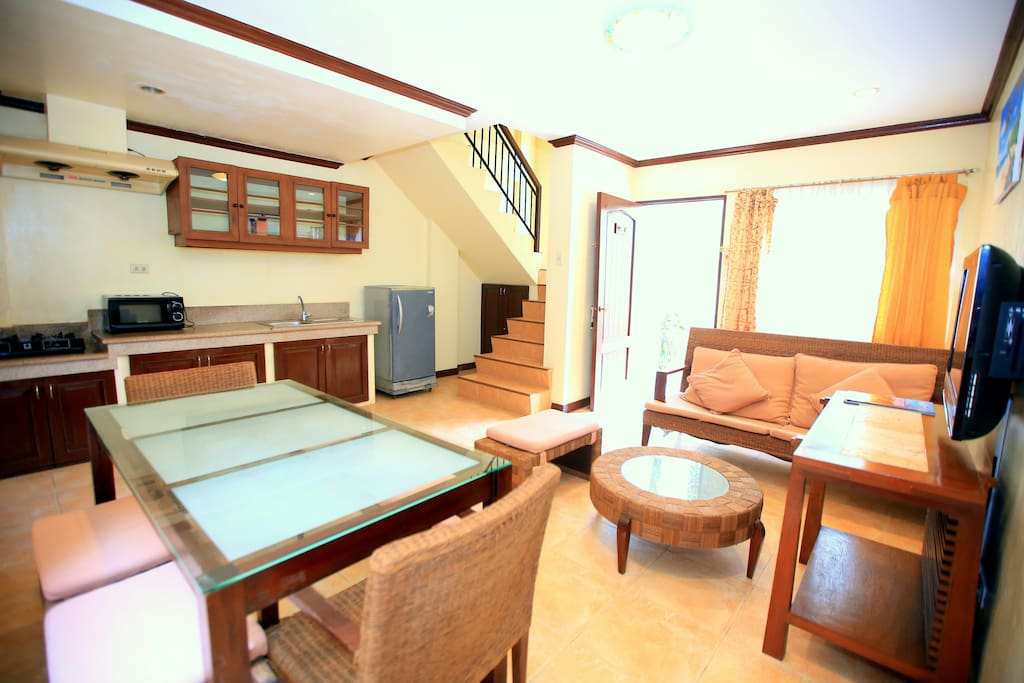 From the dining area, view of the stairs going to the bedroom